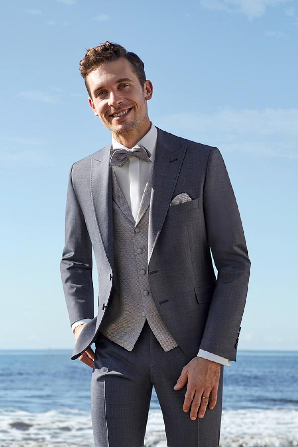 Mann in grauem Anzug von Haus der Mode Wetzlar, Hochzeitsanzüge Gießen